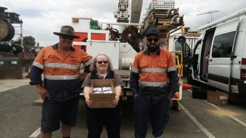 Barb giving muesli bars to SA Power Networks in Kangaroo Island after the fires.